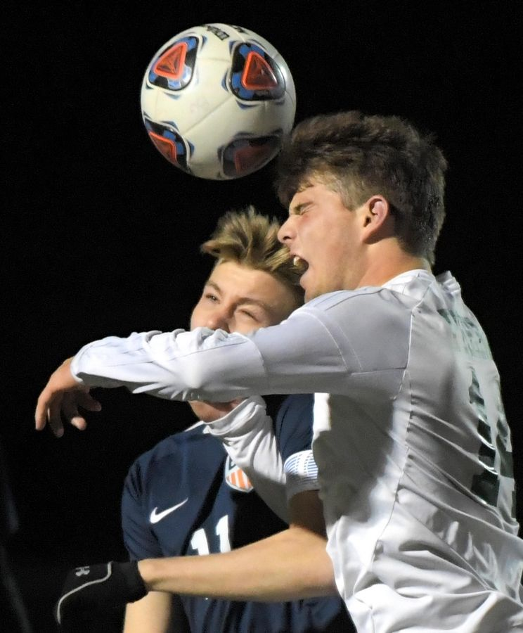 Fremd's Jake Schoffstall and Buffalo Grove's Christian Kozaczka collide in front of the net Thursday in a Mid Suburban-League Soccer Bowl game in Buffalo Grove.