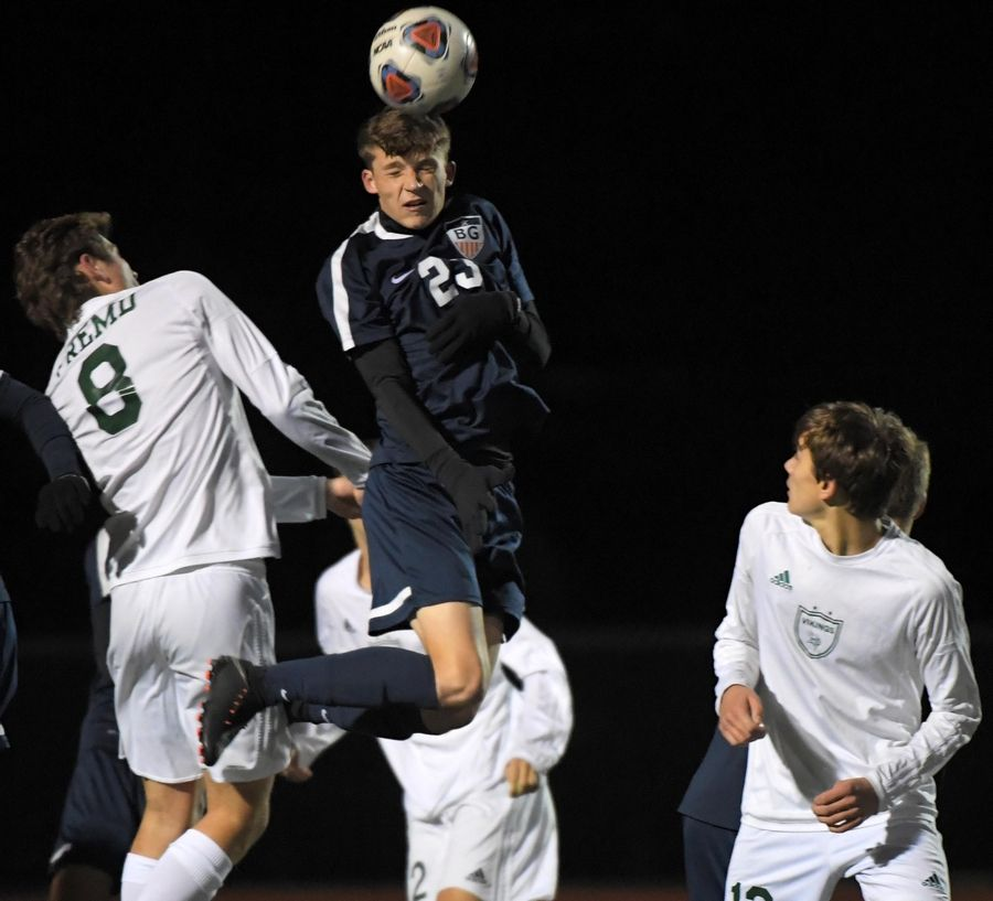 Buffalo Grove's Jack Coughlin defends his net with a header against Fremd Thursday in a Mid-Suburban League Soccer Bowl game in Buffalo Grove.