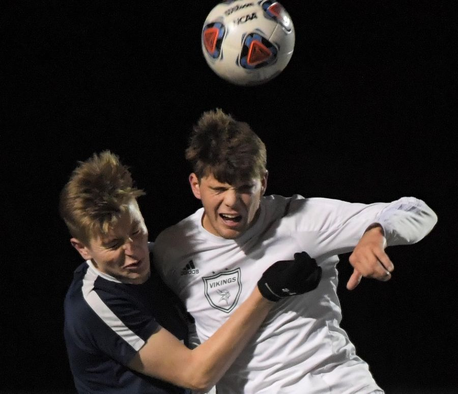 Fremd's Jake Schoffstall and Buffalo Grove's Christian Kozaczka collide as they compete for the ball Thursday in a Mid Suburban League Soccer Bowl boys soccer game in Buffalo Grove.