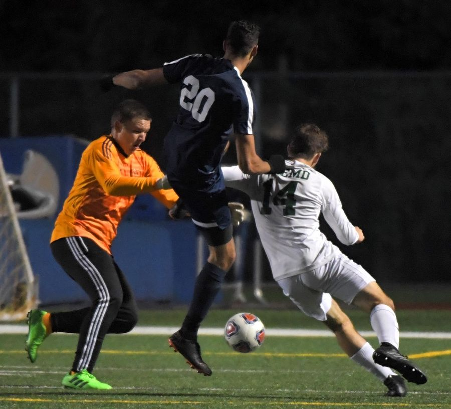 Fremd goalkeeper Artur Cholewa and teammate Jake Schoffstall stop Buffalo Grove's Jonathan Peici from scoring Thursday in a Mid Suburban League Soccer Bowl boys soccer game in Buffalo Grove.