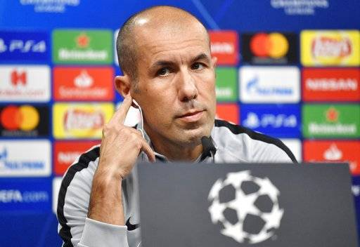 FILE - In this Oct. 2 2018 file photo, Monaco head coach Leonardo Jardim listens, during a press conference, a day ahead of the Champions League group A soccer match between Borussia Dortmund and AS Monaco in Dortmund, Germany. Monaco has fired coach Leonardo Jardim following a run of four straight losses that has left the team in the French league's relegation zone and in last place in its Champions League group.