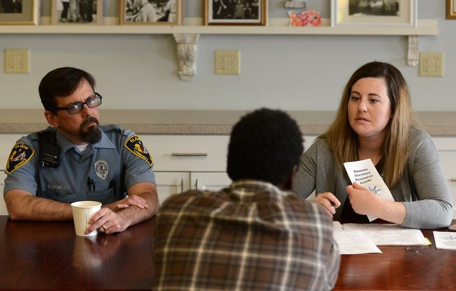 The city of Elgin is working on a long-term plan to address the needs of homeless people. Pictured here are community resource officer William Homeier and police social work intern Alison Petykowski conducting interviews with homeless people in May.