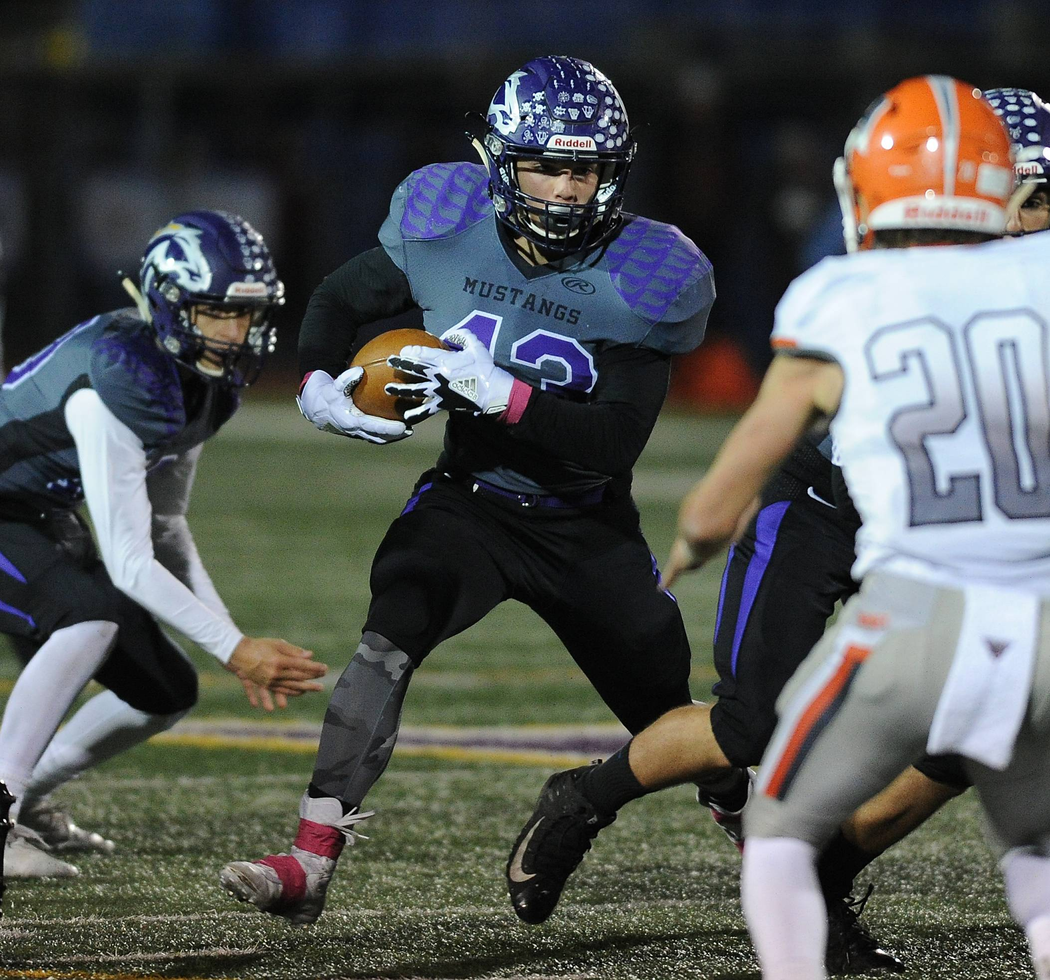 Rolling Meadows' Tim Szylak weaves his way through Hersey's defense.