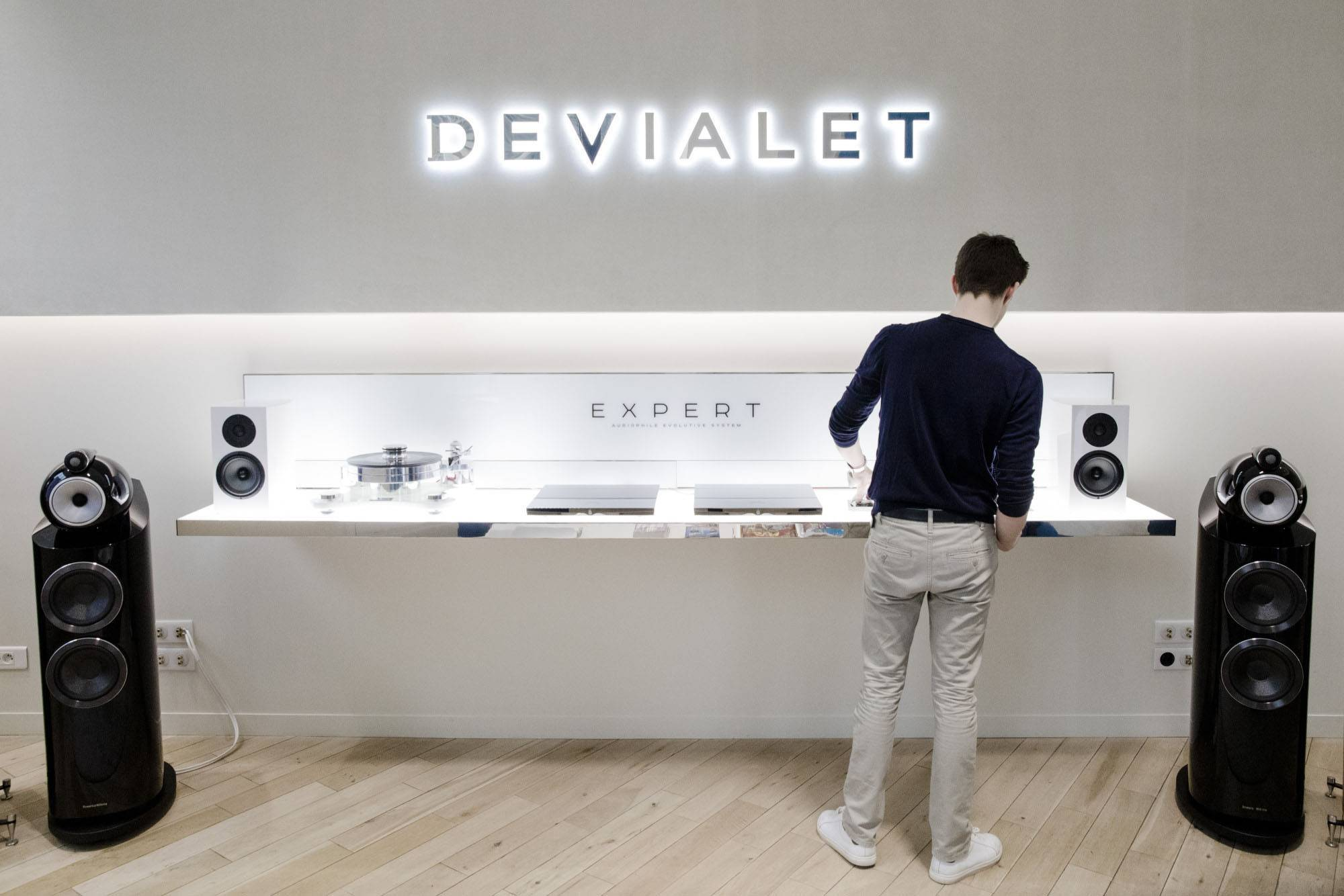 An employee tests equipment inside the Devialet SAS Analogue Digital Hybrid amplification technology showroom in Paris, France.