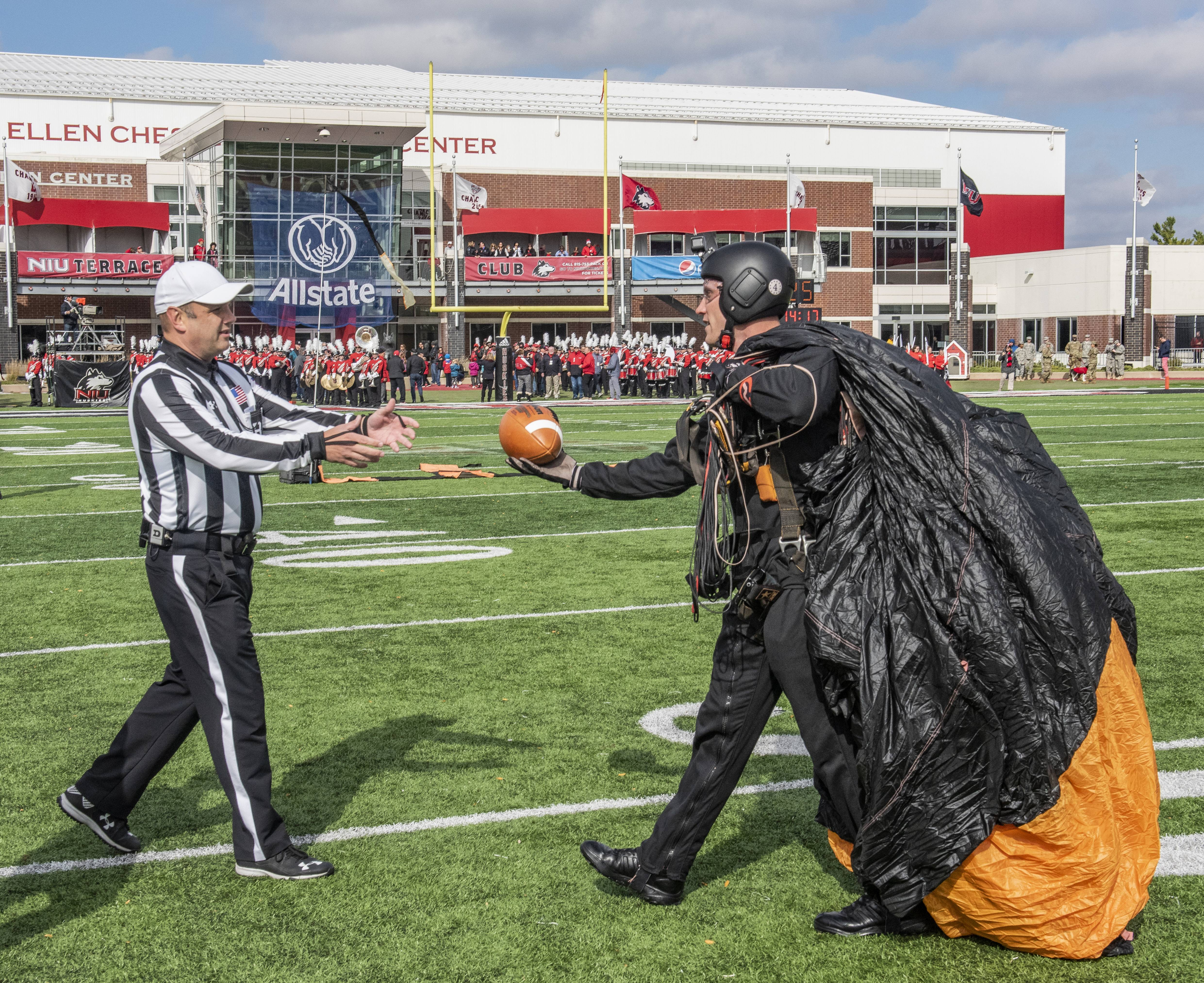COURTESY OF NIUMembers of the Golden Knights Army Parachute Team delivered the game ball for NIU's 112th homecoming game on Saturday afternoon at Huskie Stadium in DeKalb.