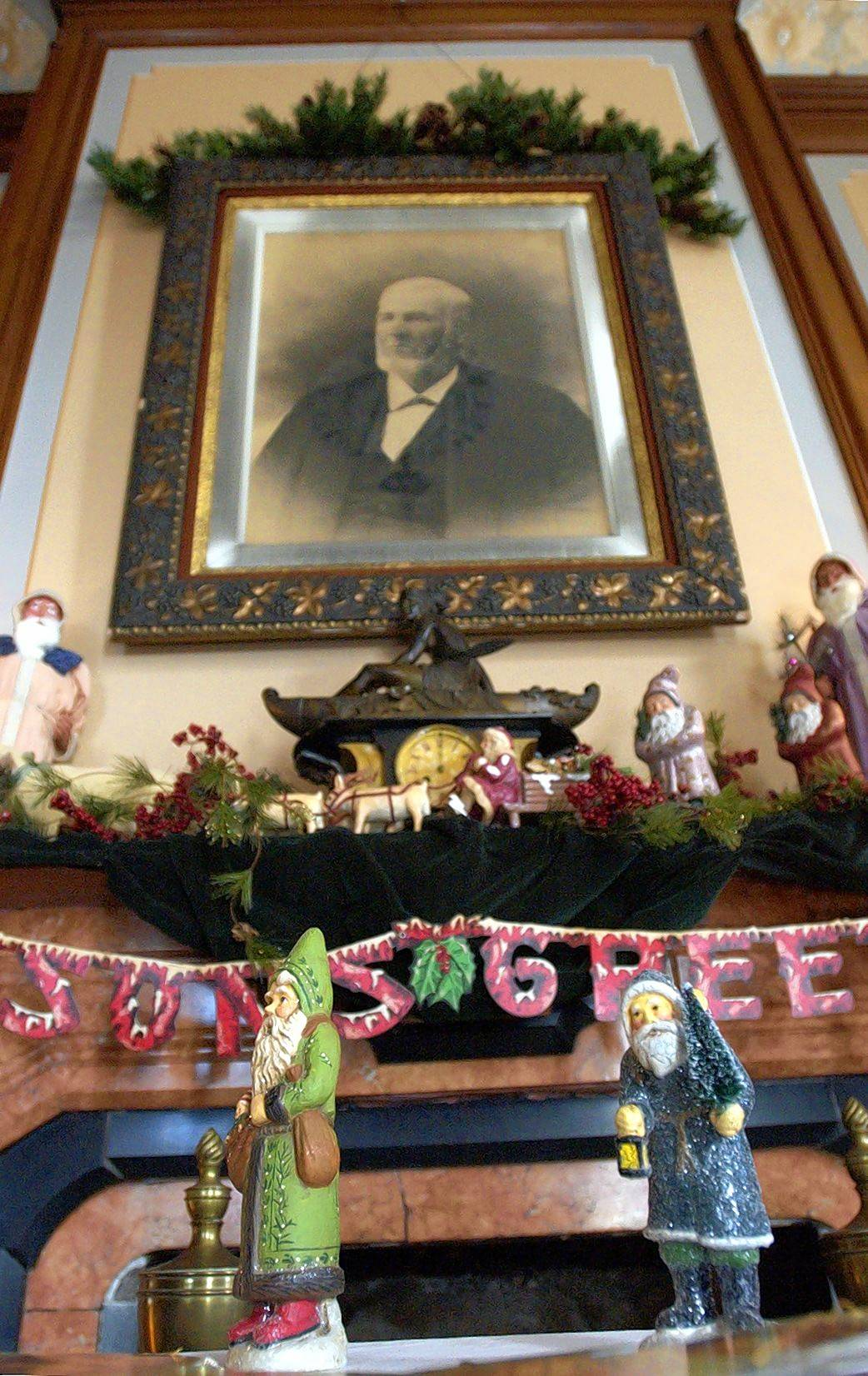 A photograph of Judge David Davis hangs above the fireplace decorated for the holidays at his former home in Bloomington.