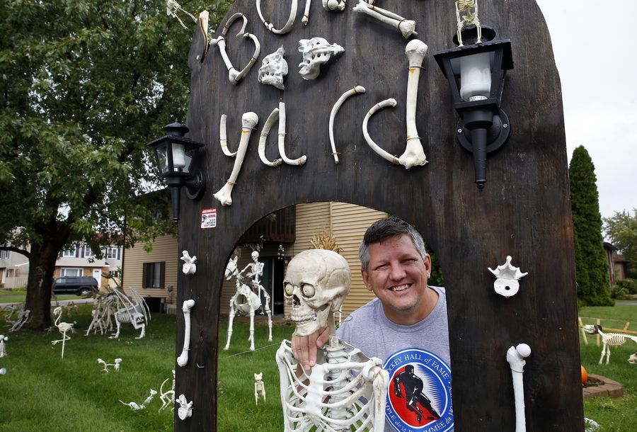 "Tom Schaefer, shown here, and his wife, Cathy, created a Facebook page for their ""Bone Yard of South Elgin"" and hope to get lots of trick-or-treaters on Halloween."