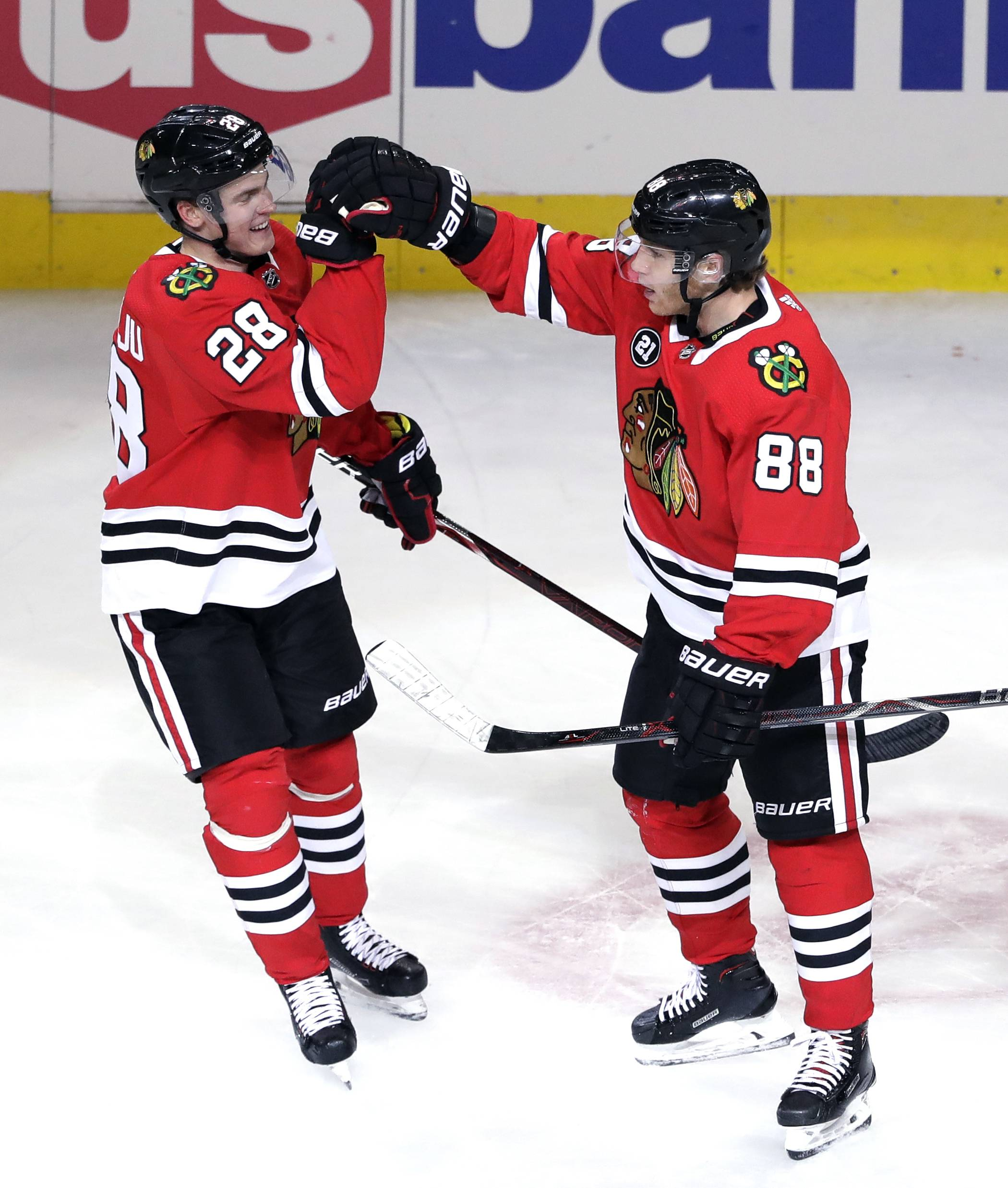 Chicago Blackhawks right wing Patrick Kane, right, celebrates with defenseman Henri Jokiharju after scoring his goal during the first period of an NHL hockey game against the St. Louis Blues, Saturday, Oct. 13, 2018, in Chicago.