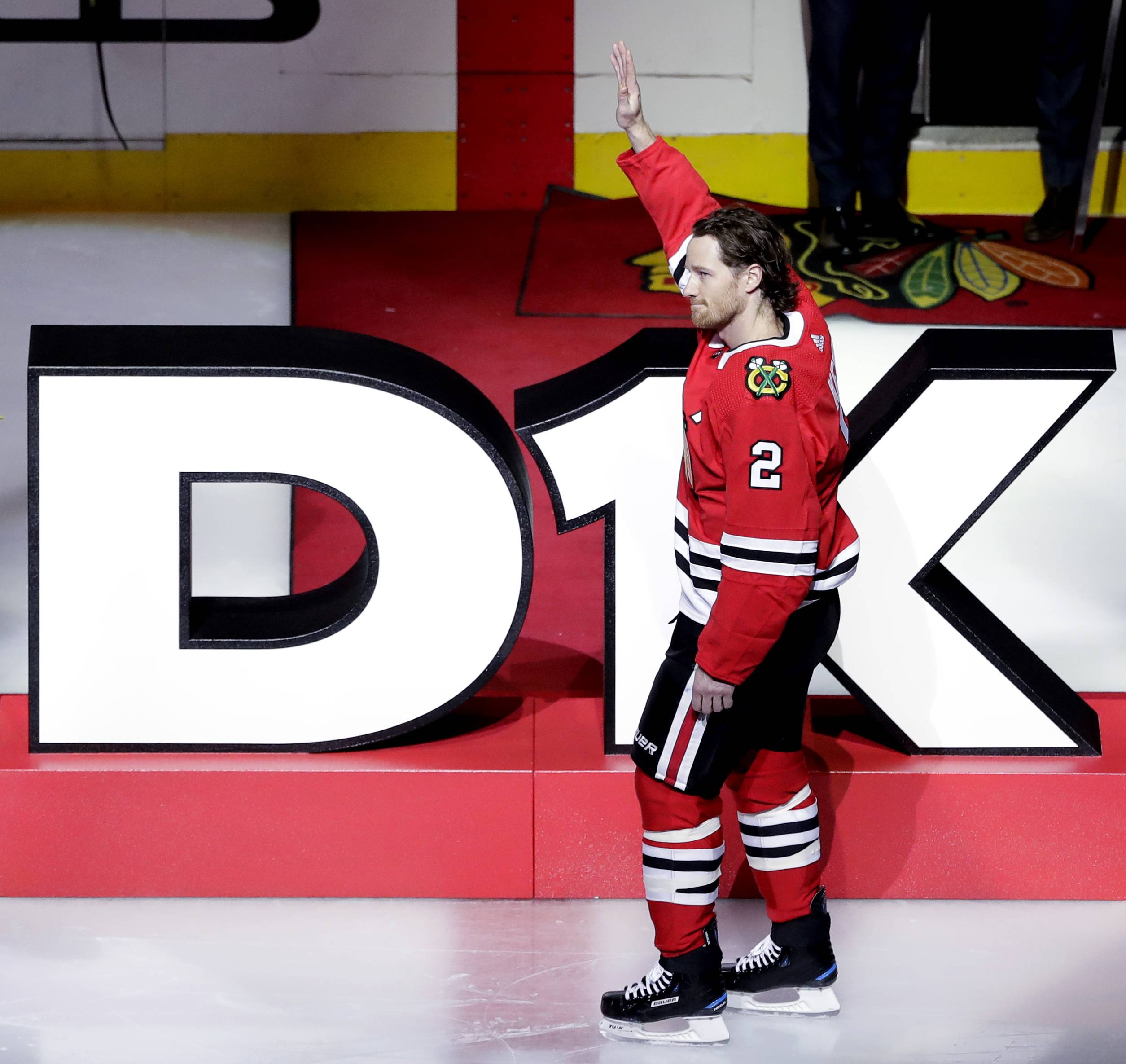 Chicago Blackhawks' Duncan Keith waves to fans during a pregame ceremony honoring for his 1000th game as a Blackhawks player before an NHL hockey game against the St. Louis Blues, Saturday, Oct. 13, 2018, in Chicago.