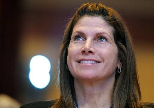 FILE - In this Feb. 12, 2011, file photo, then-Rep. Mary Bono, R-Calif., listens at the Conservative Political Action Conference (CPAC) in Washington.  USA Gymnastics has hired Bono as interim president and chief executive officer. The organization announced the move Friday, Oct. 12, 2018. Bono will hold the position while USA Gymnastics searches for a permanent successor to Kerry Perry, who resigned under pressure from the United States Olympic Committee in September after spending nine months on the job.
