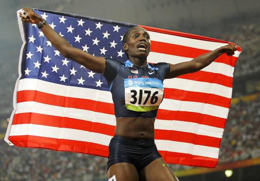 FILE - In this Aug. 19, 2008 file photo, U.S. Olympian Dawn Harper-Nelson celebrates winning the gold medal in the women's 100-meter hurdles during the athletics competitions at the Beijing 2008 Olympics in Beijing. More than 20 years after going over her first hurdle, Harper-Nelson has decided to pursue other dreams. Citing a desire to start her family, the 2002 graduate of East St. Louis Senior High School has announced her retirement from track and field competition.