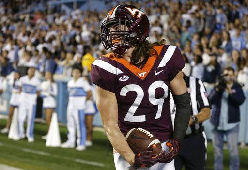 Virginia Tech's Dalton Keene (29) reacts as he runs the ball into the end zone for the game winning touchdown late in the second half of an NCAA college football game against North Carolina in Chapel Hill, N.C., Saturday, Oct. 13, 2018.