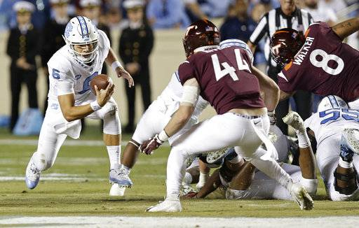 North Carolina quarterback Cade Fortin (6) runs the ball while Virginia Tech's Dylan Rivers (44) looks to tackle him during the first half of an NCAA college football game in Chapel Hill, N.C., Saturday, Oct. 13, 2018.