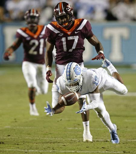 North Carolina's Dazz Newsome (19) reaches for a pass while Virginia Tech's Josh Jackson (17) defends during the first half of an NCAA college football game in Chapel Hill, N.C., Saturday, Oct. 13, 2018.