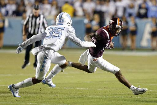 North Carolina's Greg Ross (35) chases Virginia Tech's Damon Hazelton during the first half of an NCAA college football game in Chapel Hill, N.C., Saturday, Oct. 13, 2018.