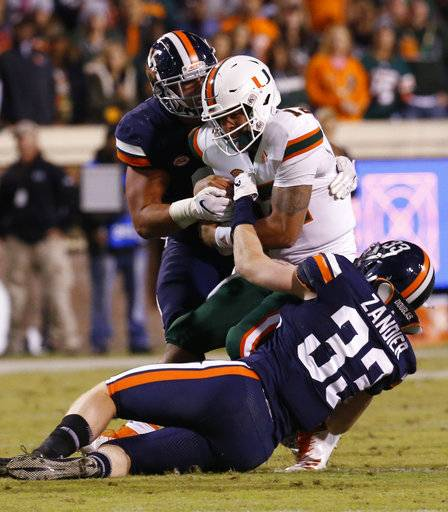 Miami quarterback Malik Rosier (12) is sacked by Virginia linebacker Zane Zandier (33) and defensive end Mandy Alonso, left, during the first half of an NCAA college football game in Charlottesville, Va., Saturday, Oct. 13, 2018.