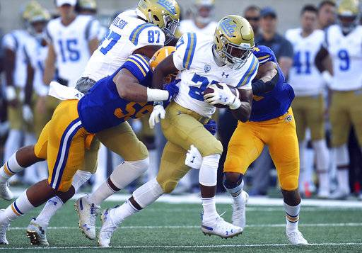 UCLA's Joshua Kelley (27) rushes against California during the first half of an NCAA college football game Saturday, Oct. 13, 2018, in Berkeley, Calif.