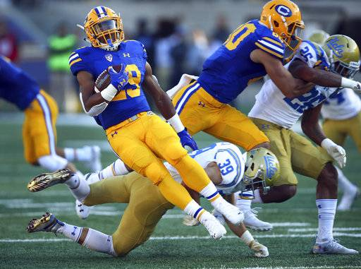 California running back Marcel Dancy, front left, gets turned around by UCLA's Ethan Fernea (39) during the first half of an NCAA college football game Saturday, Oct. 13, 2018, in Berkeley, Calif.