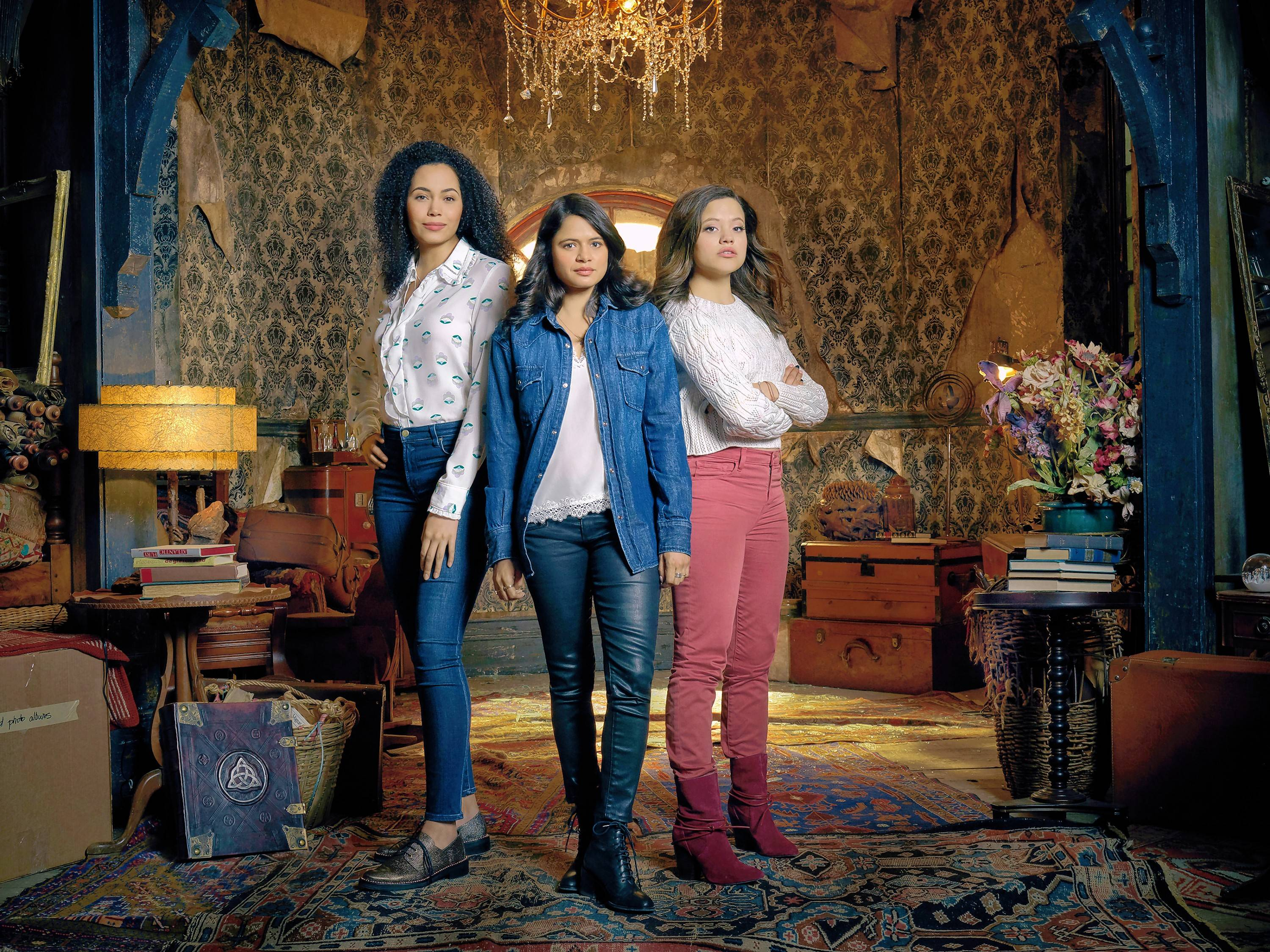 "Three sister witches (Madeleine Mantock, left, Melonie Diaz and Sarah Jeffery) unite their special powers in The CW's ""Charmed."""