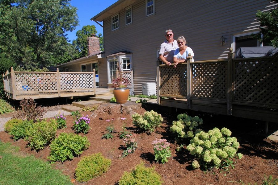 Jill and Don Gross of Roselle are enjoying their new landscaping won in the Daily Herald's Get Your Summer On makeover contest.