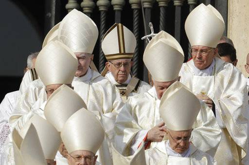 Pope Francis, center, arrives for a canonization ceremony in St. Peter's Square at the Vatican, Sunday, Oct. 14, 2018. Pope Francis canonizes two of the most important and contested figures of the 20th-century Catholic Church, declaring Pope Paul VI and the martyred Salvadoran Archbishop Oscar Romero as models of saintliness for the faithful today.