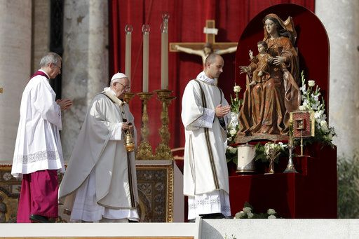Pope Francis, center, incenses the relics during a canonization ceremony in St. Peter's Square at the Vatican, Sunday, Oct. 14, 2018. Pope Francis canonizes two of the most important and contested figures of the 20th-century Catholic Church, declaring Pope Paul VI and the martyred Salvadoran Archbishop Oscar Romero as models of saintliness for the faithful today.