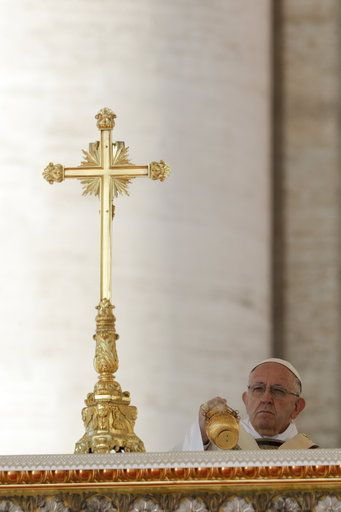 Pope Francis presides over a canonization ceremony in St. Peter's Square at the Vatican, Sunday, Oct. 14, 2018. Pope Francis canonizes two of the most important and contested figures of the 20th-century Catholic Church, declaring Pope Paul VI and the martyred Salvadoran Archbishop Oscar Romero as models of saintliness for the faithful today.