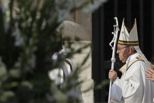 Pope Francis arrives for a canonization ceremony in St. Peter's Square at the Vatican, Sunday, Oct. 14, 2018. Pope Francis canonizes two of the most important and contested figures of the 20th-century Catholic Church, declaring Pope Paul VI and the martyred Salvadoran Archbishop Oscar Romero as models of saintliness for the faithful today.