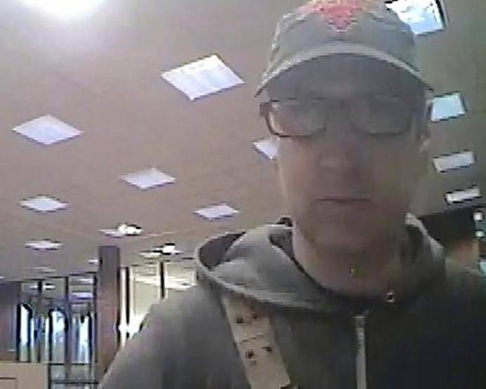 Federal authorities say this is Eric M. Dill, 39 of Barrington, in an image captured during an Oct. 10 robbery of the BMO Harris Bank in Carpentersville. Dill was captured the next day, authorities say.