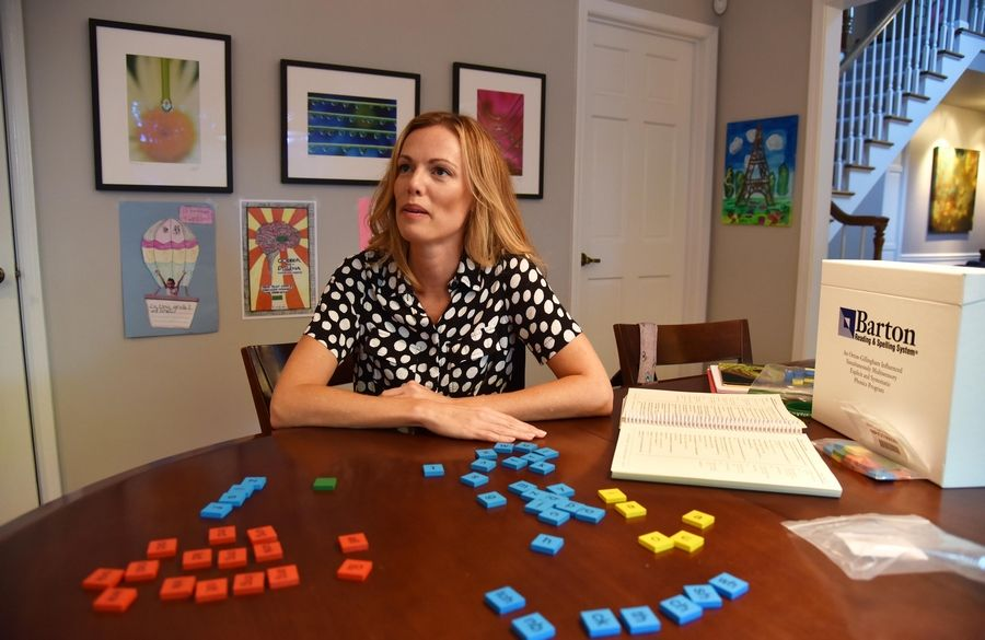 Jenine Hanson, a member of Dyslexia Action Group of Naperville, uses the Barton Reading & Spelling System to tutor her daughter on the skills she needs to overcome the reading and decoding struggles of dyslexia.