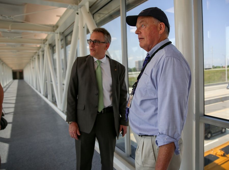 Pace Deputy Executive Director Rocky Donahue, left, and departing Pace Executive Director T.J. Ross stand in the walkway over Interstate 90 at a new transit station at Barrington Road that allows express buses to stop on the tollway.