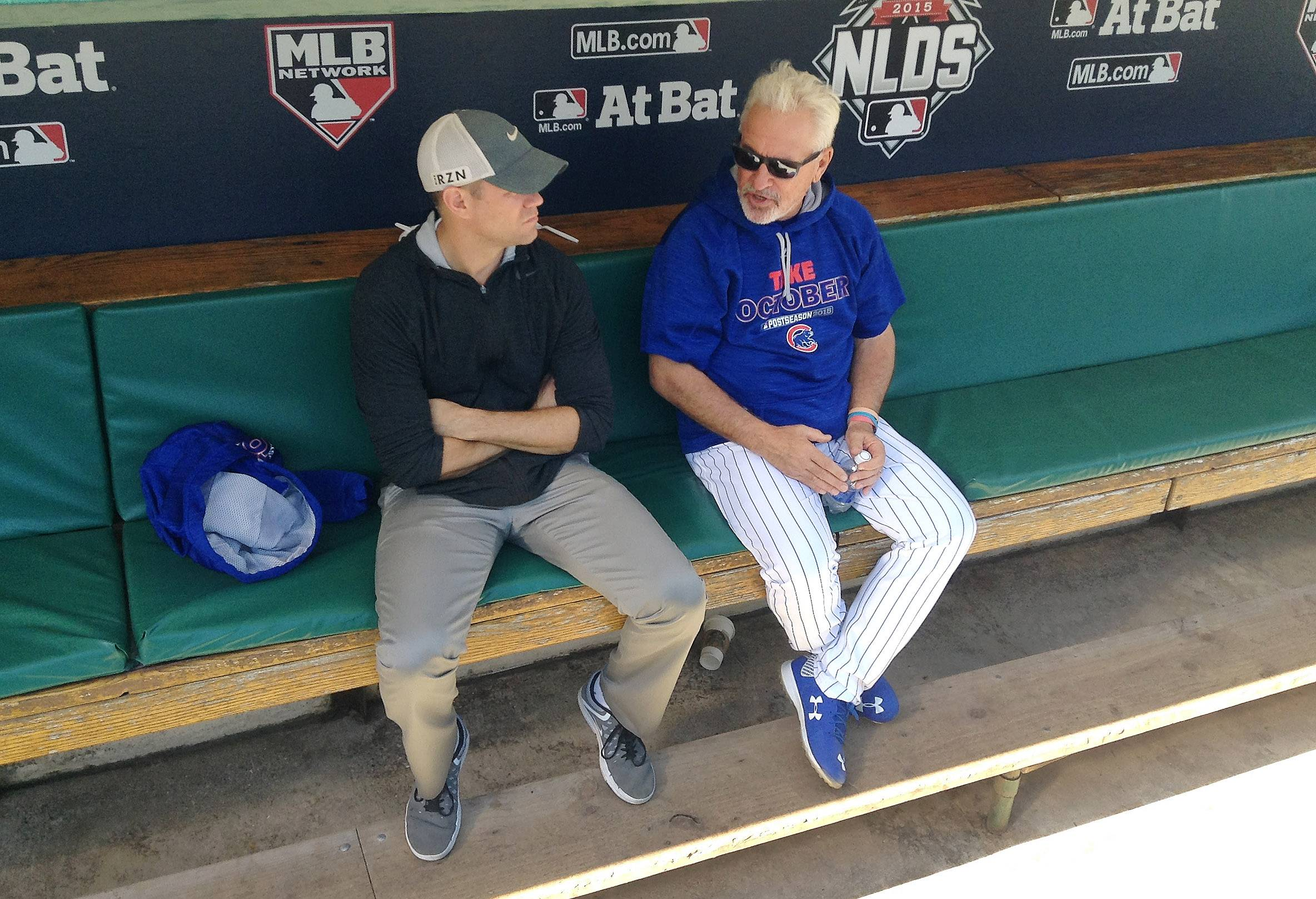 Cubs president Theo Epstein, left, and manager Joe Maddon share a moment in the Cubs dugout during a workout before Game 3 of the 2015 NLDS at Wrigley Field. It would be difficult for Epstein to blame Maddon for the Cubs' disappointing postseason showing this year, although he did fire pitching coach Chris Bosio and hitting coach John Mallee a year ago after three straight NLCS appearances and a World Series title.