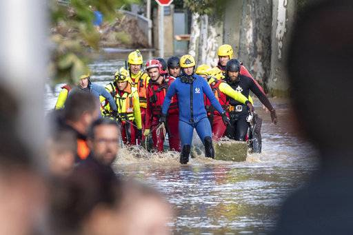 This photo provided by Stephane Jourdain, after a torrent of water ripped out the bridge in Villegailhenc, southern France, Monday Oct. 15, 2018. Flash floods have left several people dead in southwest France, with roads swept away and streams become raging torrents as the equivalent of several months of rain fell overnight, authorities said Monday.
