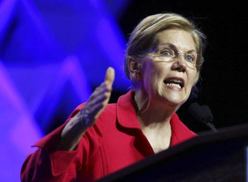 FILE - In this June 1, 2018 file photo, Sen. Elizabeth Warren, D-Mass., speaks at the 2018 Massachusetts Democratic Party Convention in Worcester, Mass.   Warren has released results of a DNA test showing Native American ancestry in an effort to diffuse the issue ahead of any presidential run.
