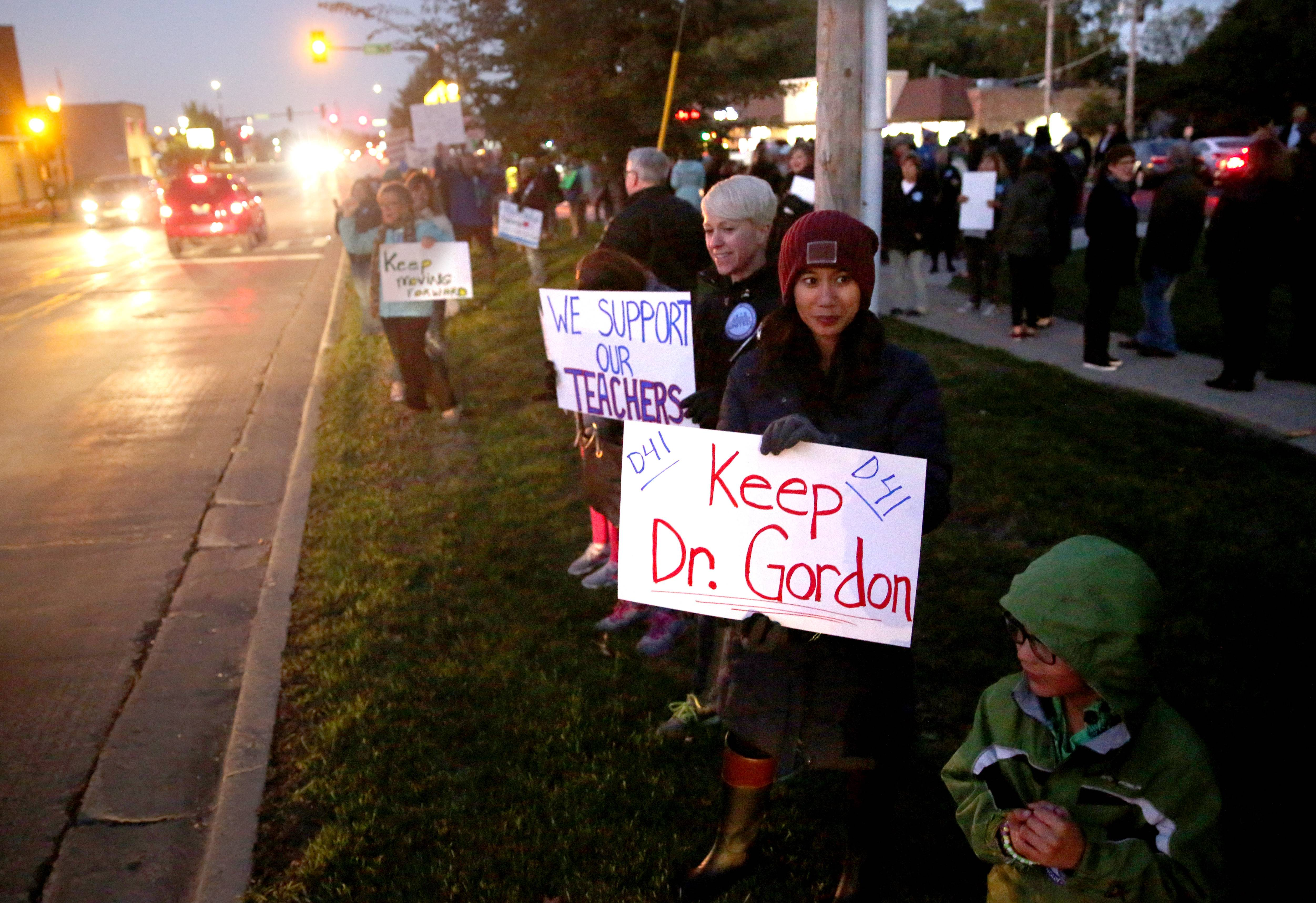 Demonstrators show support for Superintendent Paul Gordon before and during a Glen Ellyn District 41 board meeting Monday night. Here, district parent Tina Michaels holds a sign at a rally.