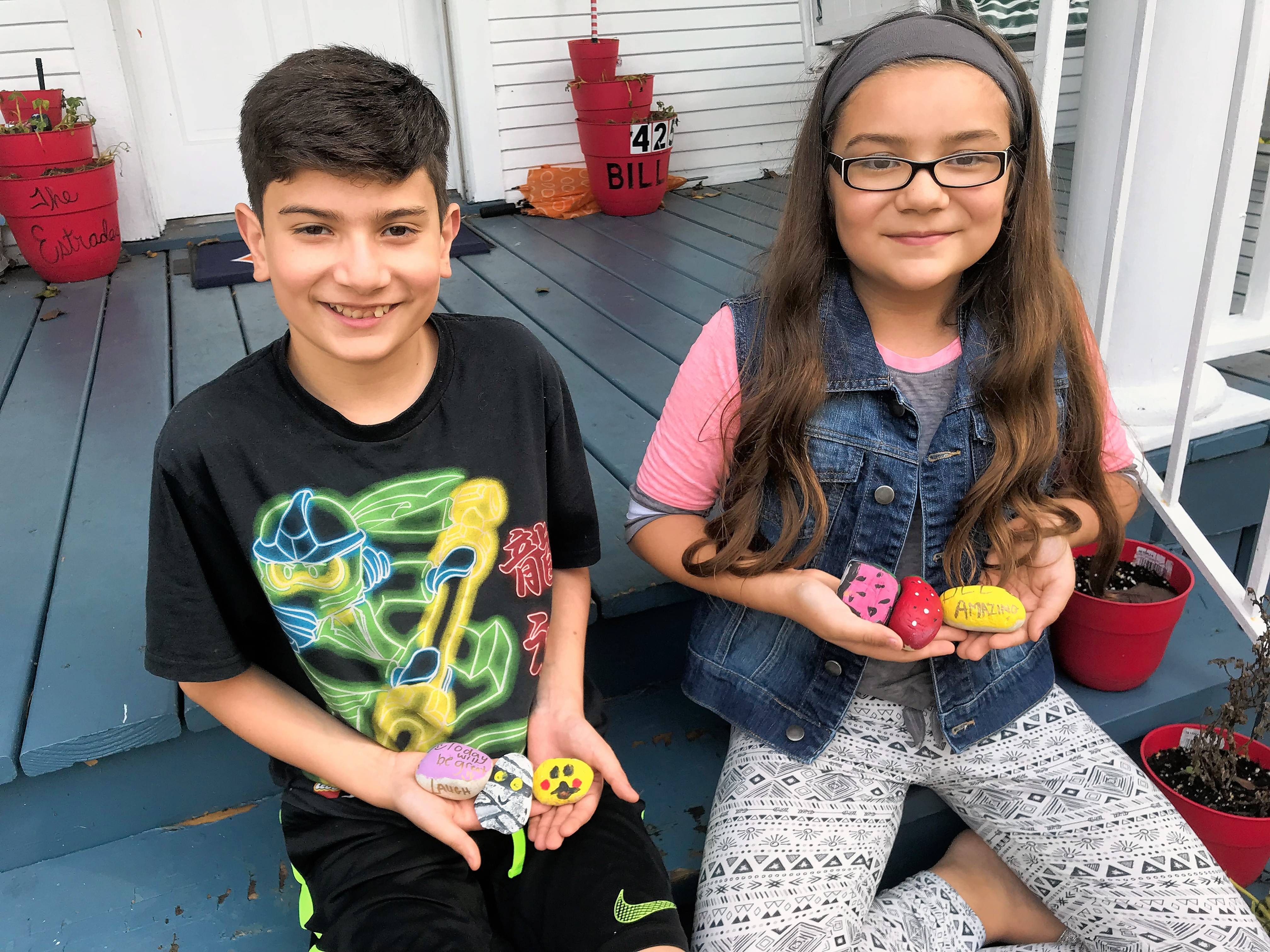 "Bryan Estrada, 11, left, and his sister, Aubree, 10, of Elgin show off some of the ""Elgin rocks"" they painted."