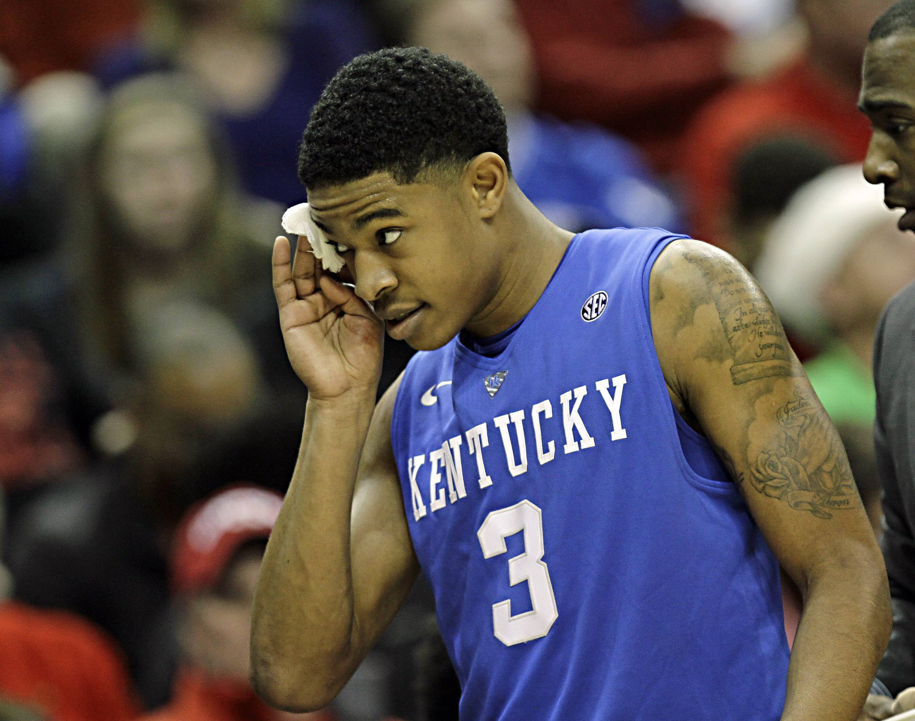 Kentucky freshman guard Tyler Ulis was forced to the bench by a cut over his right eye in the first half, but came back to led Kentucky to a 58-50 victory over Louisville in their NCAA college basketball game in Louisville, Ky., Saturday, Dec. 27, 2014. (AP Photo/Garry Jones)