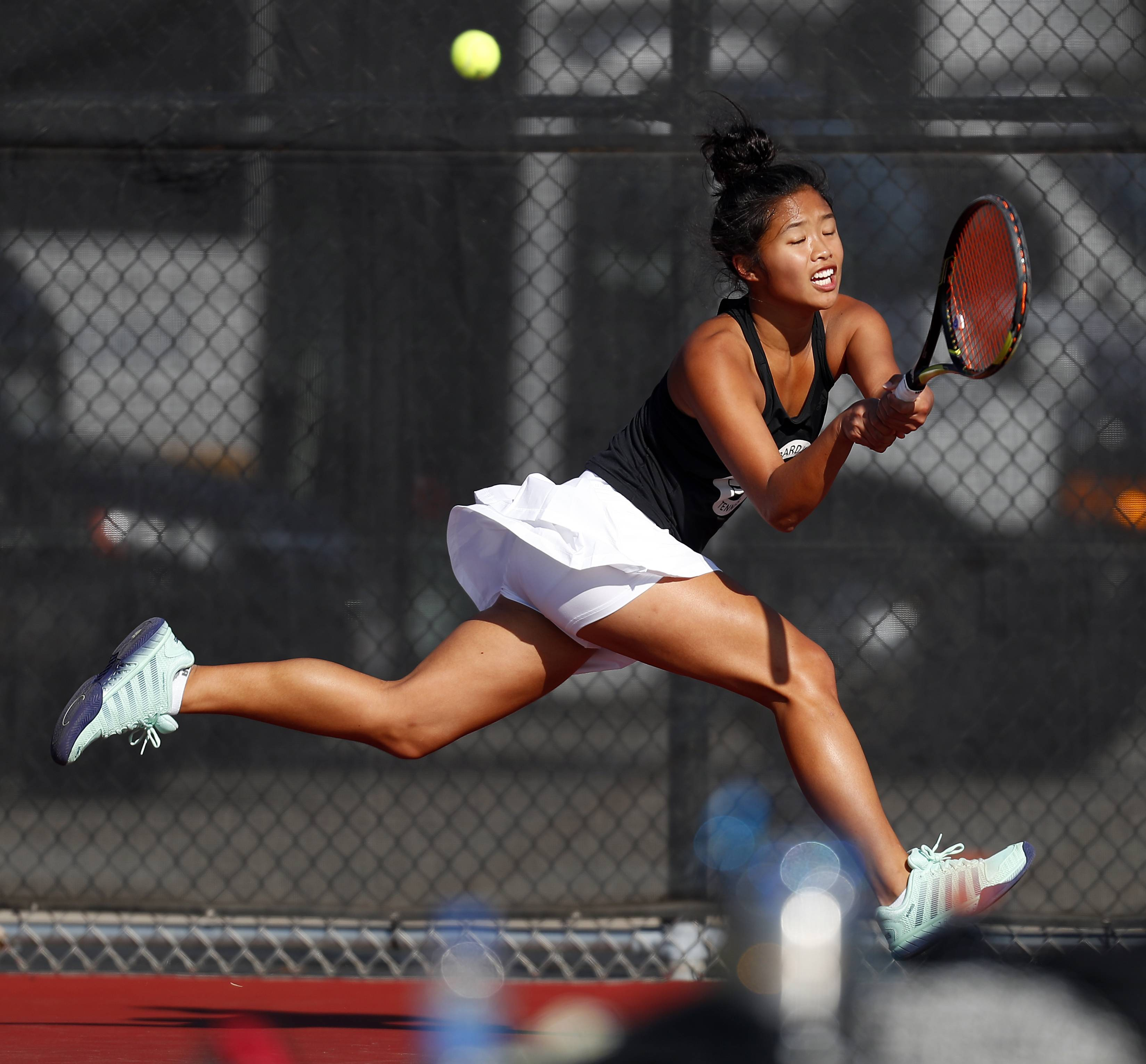 Sienna Lopez of Glenbard West competes Saturday during the St. Charles East girls tennis sectional.