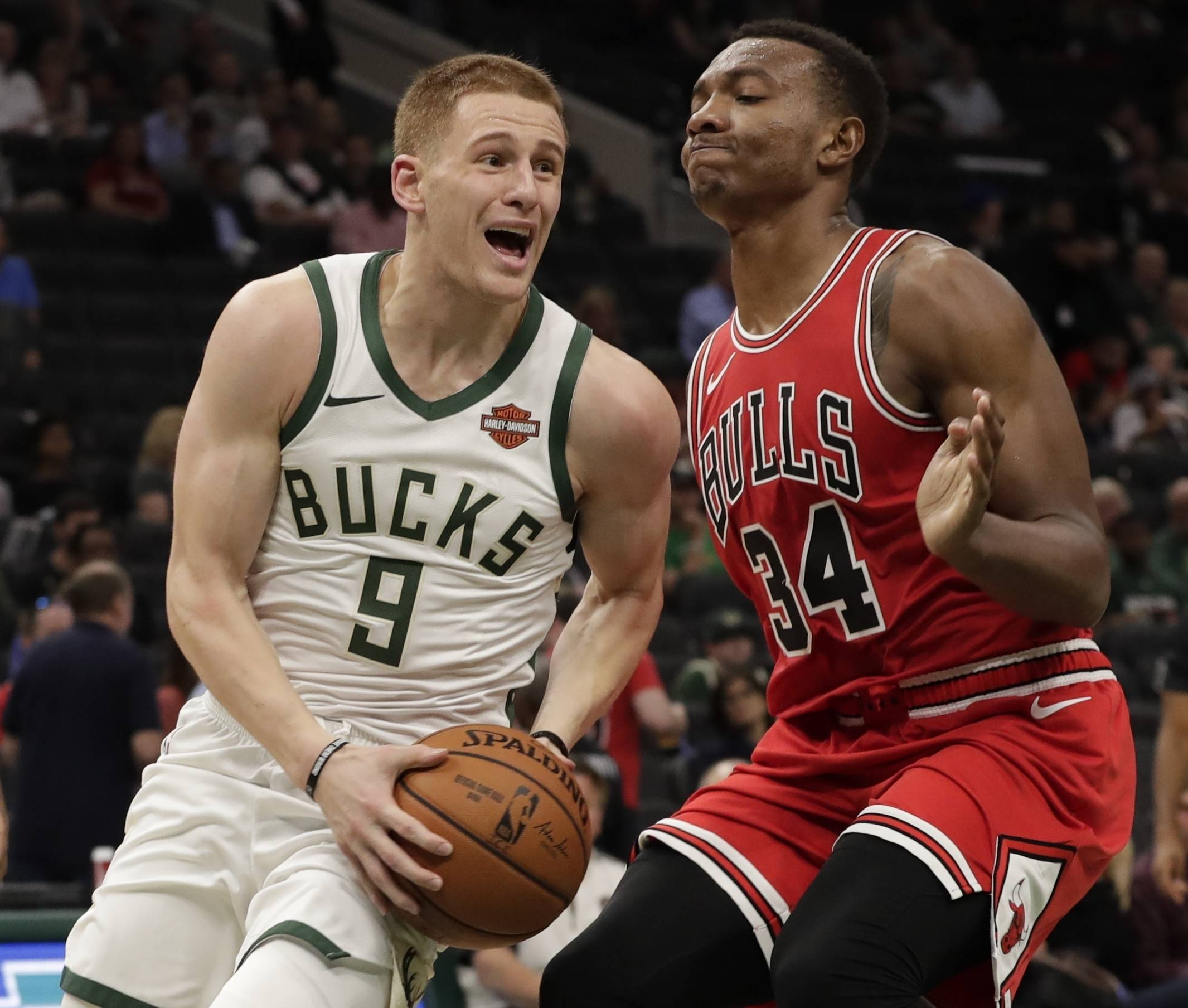 The Bulls' Wendell Carter Jr. shuts down Milwaukee's Donte DiVincenzo in a preseason game this month. In Thursday's season-open at Philadelphia, the Bulls' rookie gets to work against the Sixers' 7-foot center Joel Embiid.