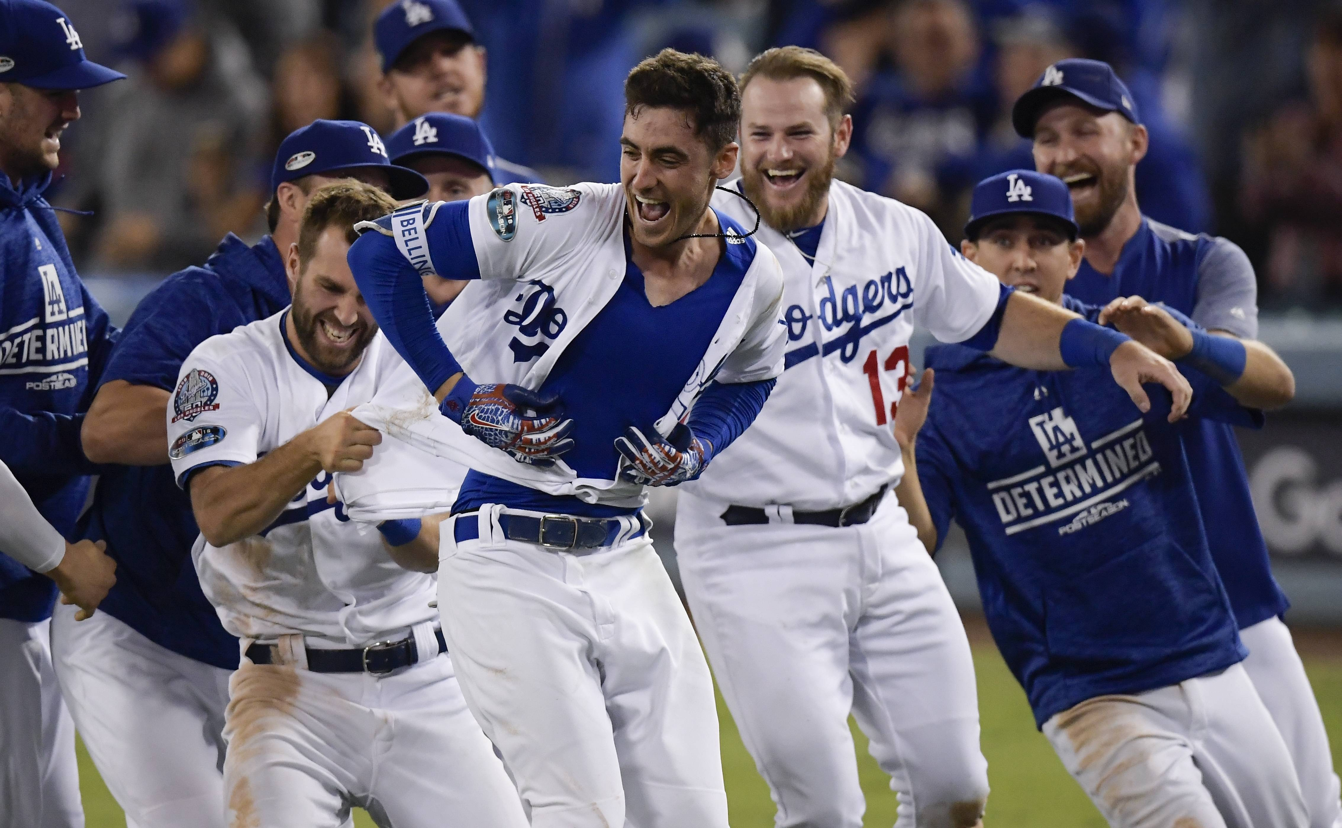 Los Angeles Dodgers' Cody Bellinger reacts after hitting a walk-off hit during the 13th inning of Game 4 of the National League Championship Series baseball game against the Milwaukee Brewers Tuesday, Oct. 16, 2018, in Los Angeles. The Dodgers won 2-1 to tie the series at 2-2. (AP Photo/Mark J. Terrill)