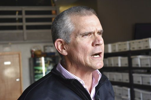 In this Oct. 6, 2018 photo Republican State Auditor Matt Rosendale discusses his campaign to defeat Montana Democratic U.S. Sen. Jon Tester at a campaign event at Lonewolf Energy in Billings, Mont. Rosendale trails in fundraising but he's stayed competitive with $14 million spent by deep-pocketed conservative groups on his behalf.