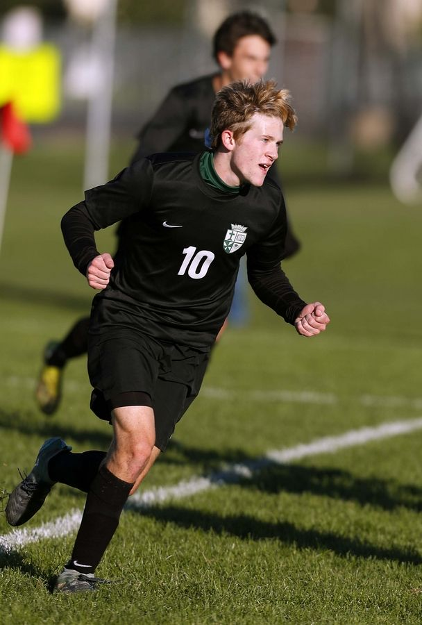 St. Edward's Zachary Olenek (10) celebrates a St. Edward goal in the first half. Olenek scored the first goal in a 4-0 victory.