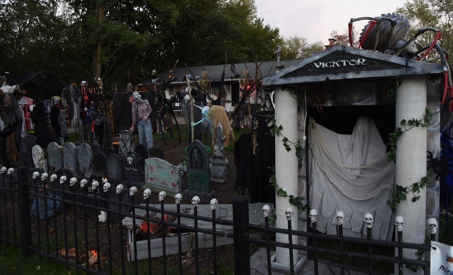 Most of the elaborate Halloween decorations on display at 1119 N. Forrest Ave. in Arlington Heights are for sale. Michael Podlin died of cancer this year, and his widow and three teenagers need money to pay the bills.