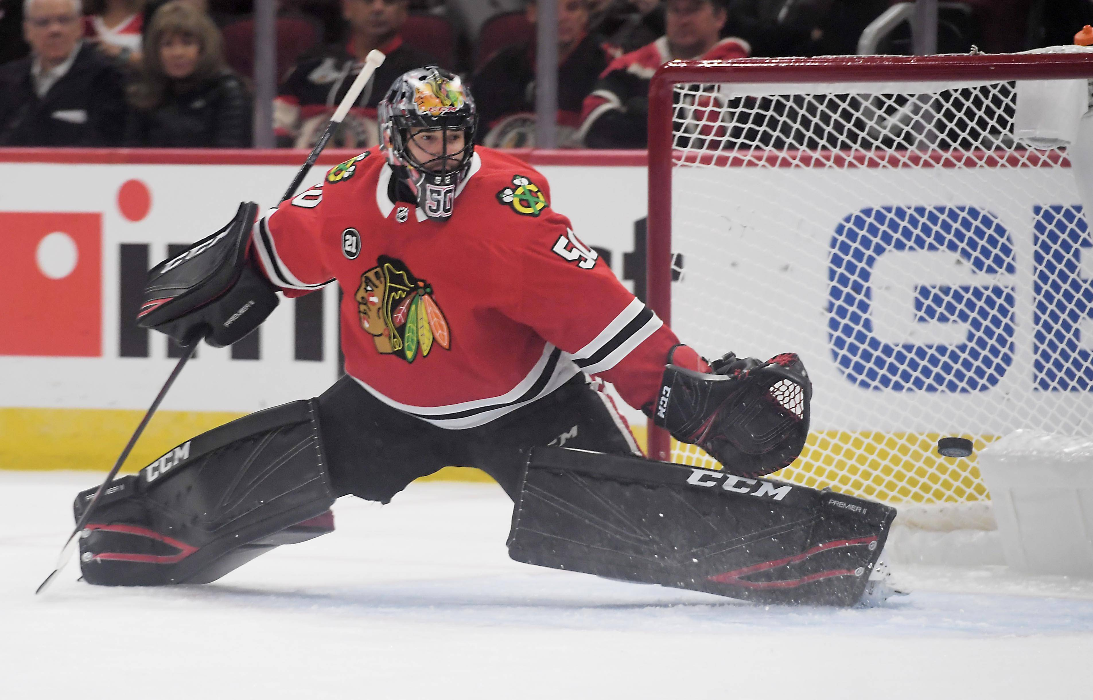 John Starks/jstarks@dailyherald.comChicago Blackhawks goaltender Corey Crawford gives up a goal to Arizona Coyotes left wing Lawson Crouse in the first period Thursday at the United Center in Chicago.