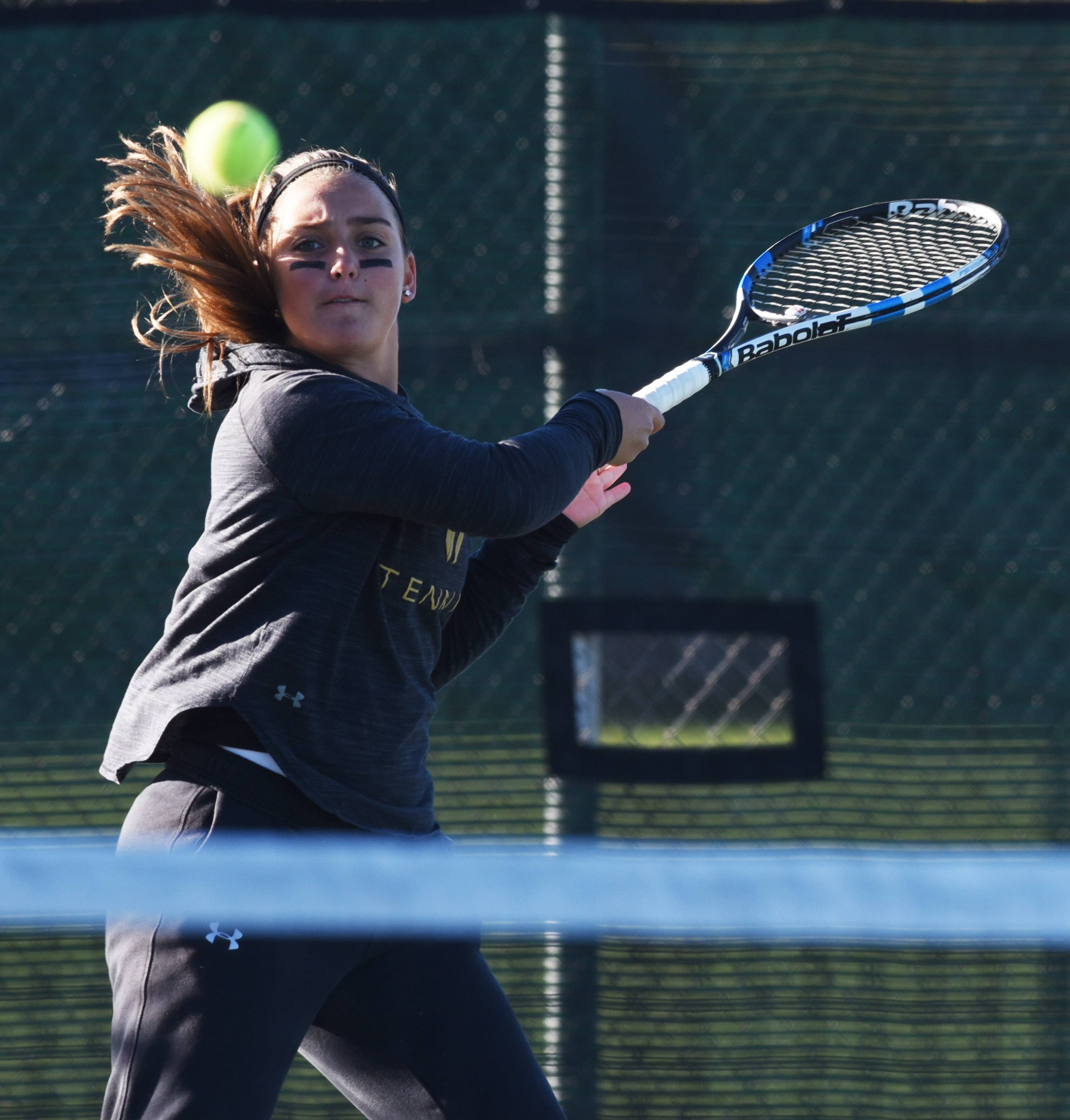 Fremd doubles player Kyra Emmanouilidis competes during the girls state tennis tournament in Palatine Thursday.