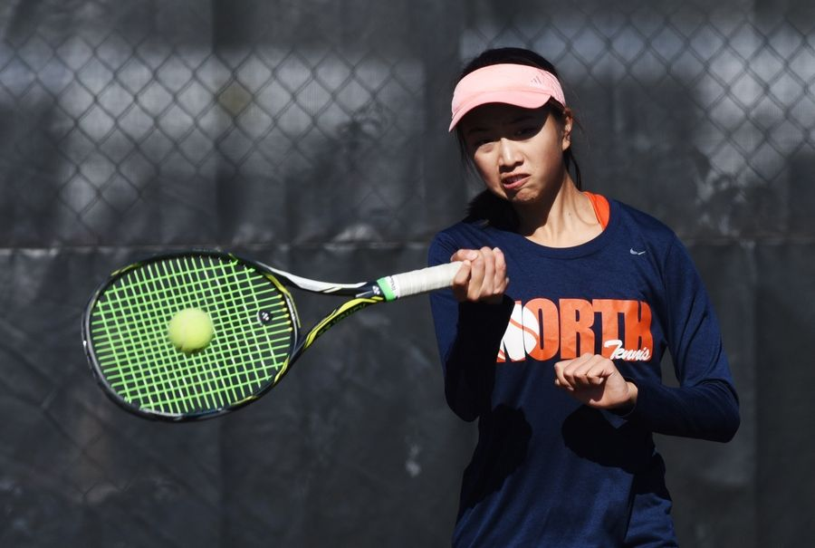 Naperville North doubles player Irene Zhang returns the ball while playing against Oak Park-River Forest during the girls state tennis tournament at Elk Grove Thursday.
