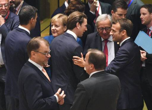 "French President Emmanuel Macron, center right, speaks with European Commission President Jean-Claude Juncker, center, and Austrian Chancellor Sebastian Kurz, center left, during a round table meeting at an EU summit in Brussels, Wednesday, Oct. 17, 2018. European Union leaders are converging on Brussels for what had been billed as a ""moment of truth"" Brexit summit but which now holds little promise for a breakthrough. (Piroschka van de Wouw, Pool Photo via AP)"