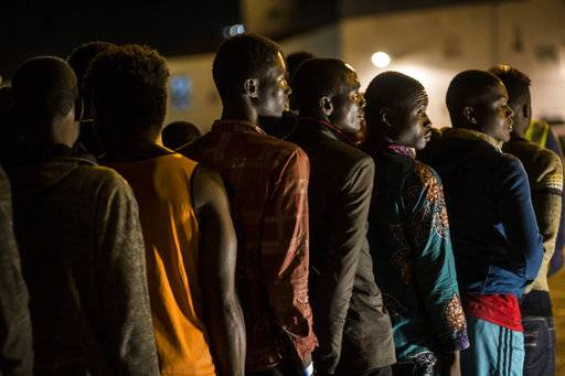 Migrants disembark at Motril port after they were rescued by Spanish NGO ProActiva Open Arms at Alboran Sea, about 40 miles (64 km) from Spanish coasts, on Thursday, Oct. 11, 2018. The Open Arms is now based at Motril port in Spain, in order to start operating in the western Mediterranean area.