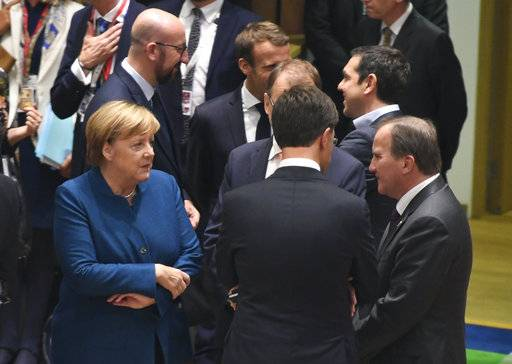 "German Chancellor Angela Merkel, left, speaks with Swedish Prime Minister Stefan Lofven, right, and Dutch Prime Minister Mark Rutte, center, during a round table at an EU summit in Brussels, Wednesday, Oct. 17, 2018. European Union leaders are converging on Brussels for what had been billed as a ""moment of truth"" Brexit summit but which now holds little promise for a breakthrough. (Piroschka van de Wouw, Pool Photo via AP)"