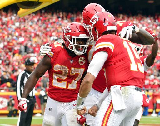 FILE - In this Oct. 7, 2018 file photo Kansas City Chiefs running back Kareem Hunt (27) celebrates his touchdown against the Jacksonville Jaguars with quarterback Patrick Mahomes (15) during the second half of an NFL football game in Kansas City, Mo. The Cincinnati Bengals bring one of the NFL's worst defenses to Arrowhead Stadium on Sunday, Oct. 21, 2018 to face the Chiefs. They also bring an ailing defense, and that should only make it tougher to slow down Patrick Mahomes and Co. The Bengals are coming off a loss to Pittsburgh while Kansas City lost for the first time last week in New England (AP Photo/Ed Zurga)